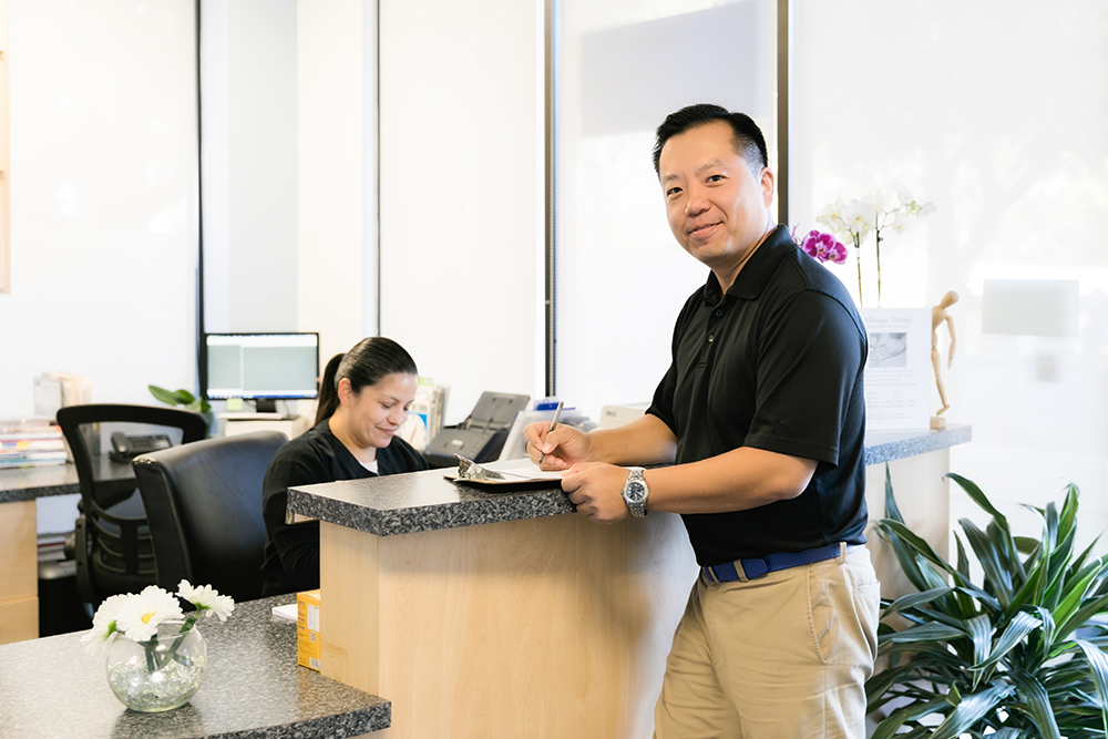 Doctor Lin welcoming Patient into office